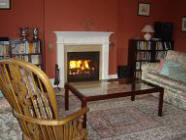 A cosy fire was very welcome  as snow fell lightly against the window outside
