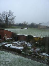 And the next day, the garden and the fields next door were covered in snow.